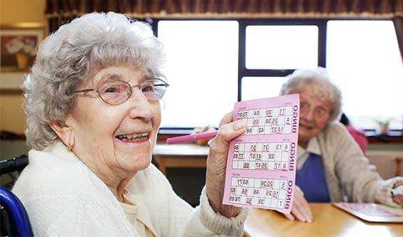 Care Home Resident Playing Bingo